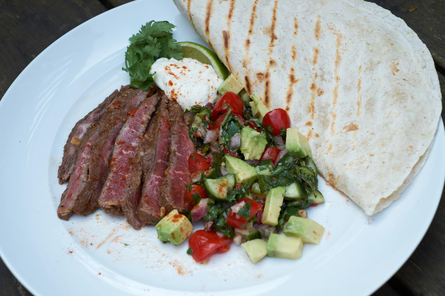 Spicy Flat Iron Steak servered with salad and bread